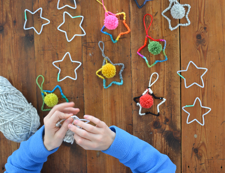 Make holiday star ornaments from pipe-cleaners and yarn.