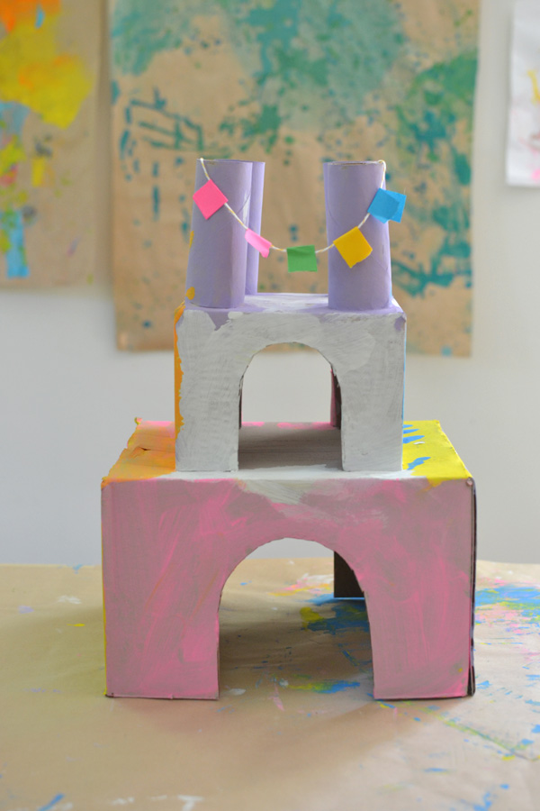 children make castles from recycled materials