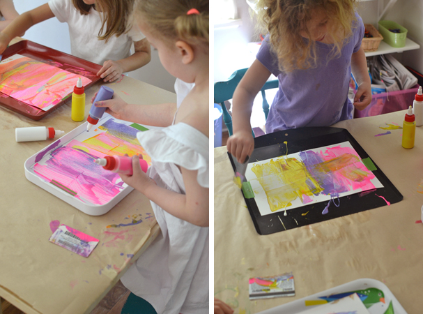 beautiful process art ~ kids love pushing and pulling and scraping the paint around in their tray ~ mixing colors and seeing what will happen is one big art experiment and so much fun!