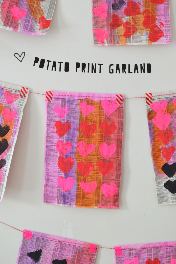 heart shaped potato stamped garland on phone book pages