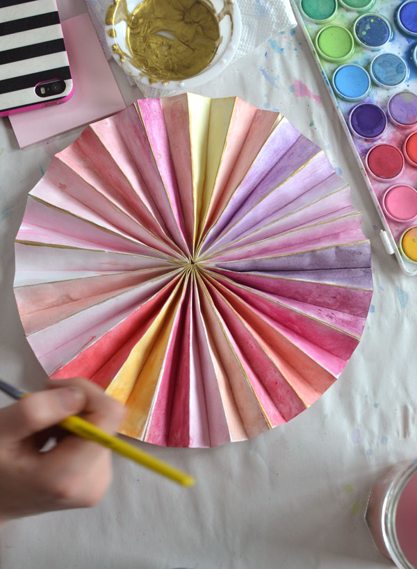paper pinwheels made to be painted as a birthday party craft