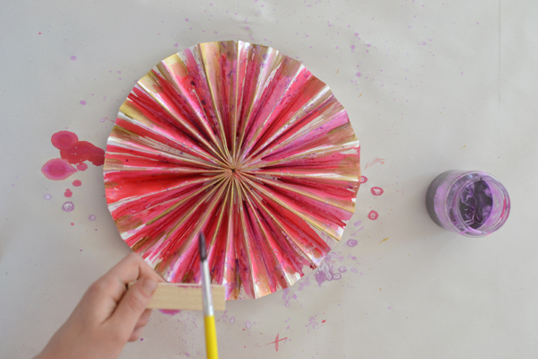 make paper pinwheels and paint them with watercolors