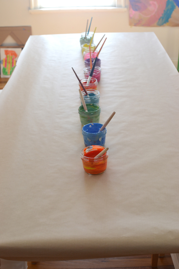 4yr olds work together to make a big painting