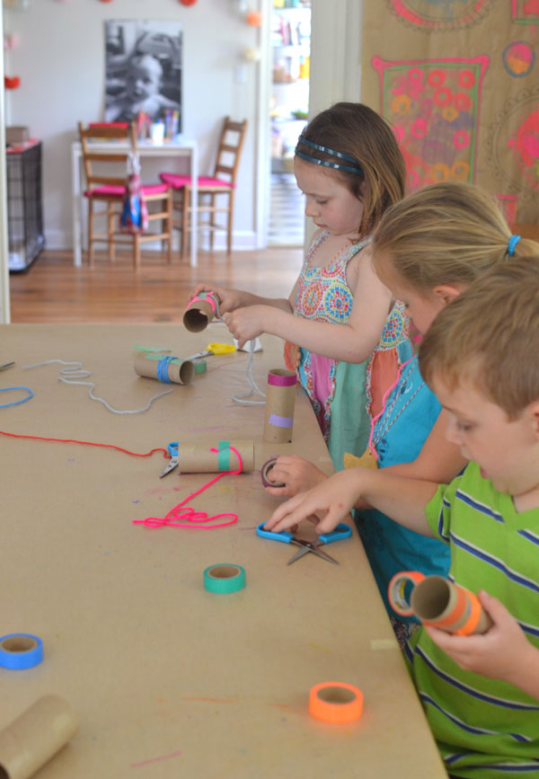 kids make this simple binocular craft with yarn and colored tape