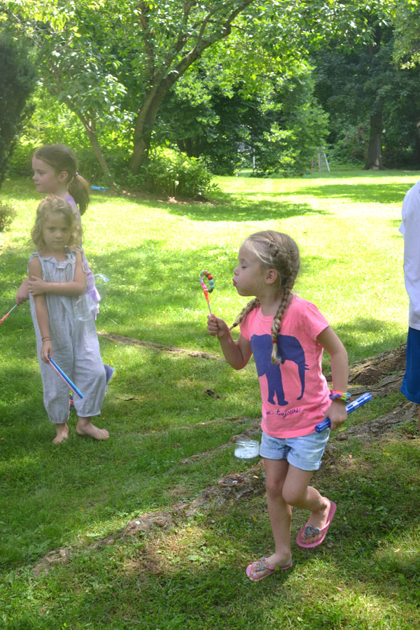Kids make their own, homemade bubble wands with pipe cleaners and beads.