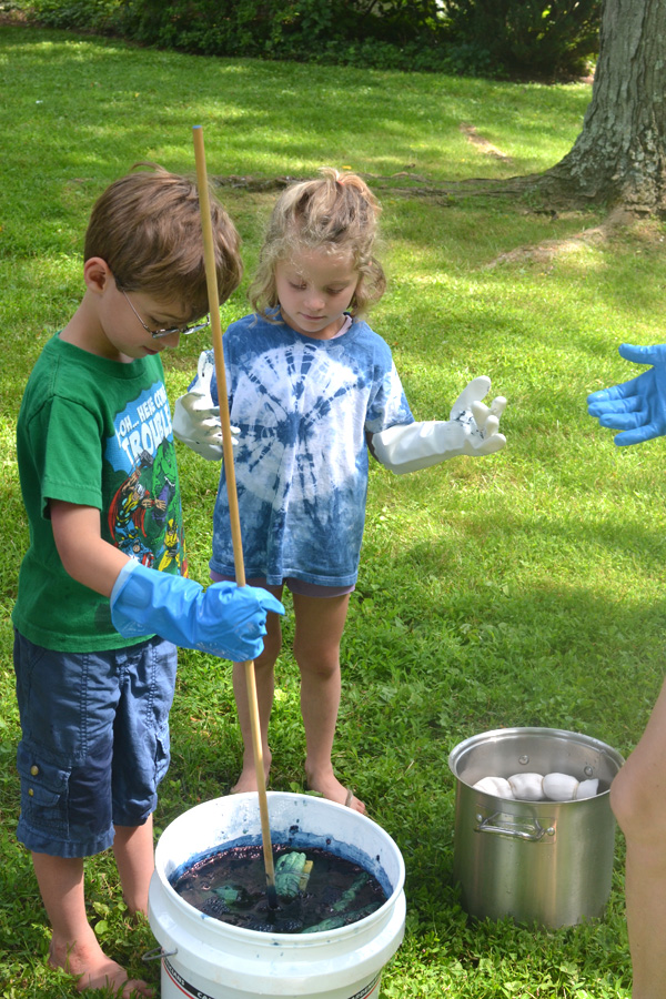Kids practice the Japenese technique of Shibori tie-dyeing.