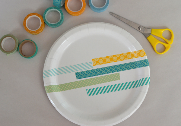 Transform a paper plate into a work of art with colorful washi tape.