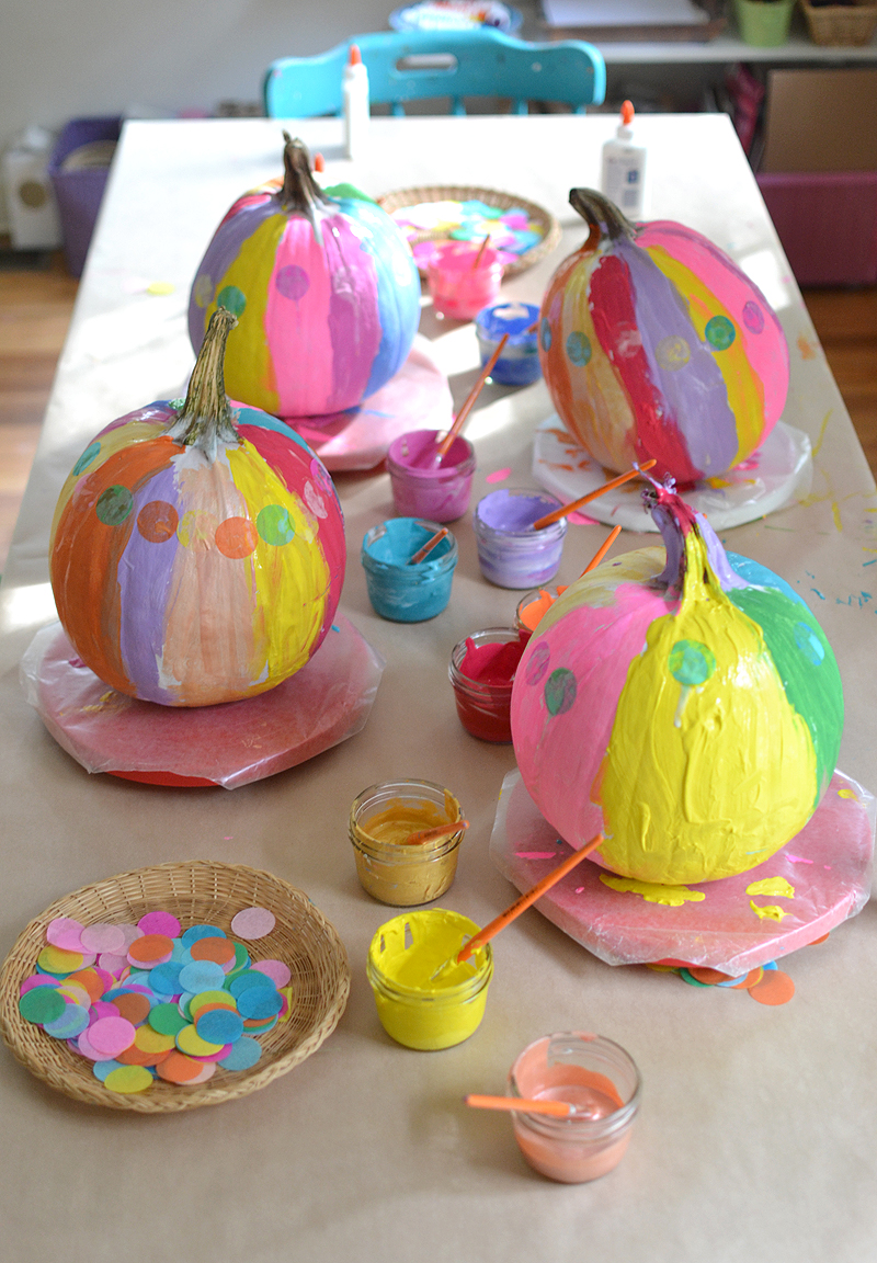 After using this one trick, the kids paint vibrant and colorful pumpkins using acrylics and collaging with tissue paper.