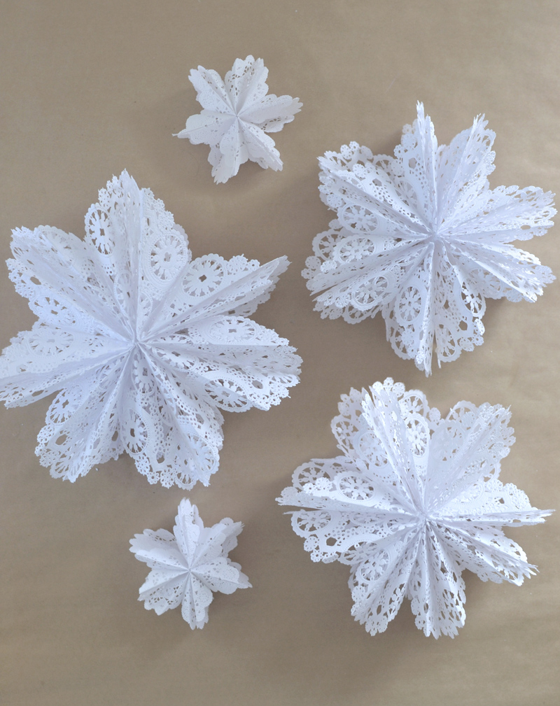 Make 3D snowflake stars from doilies and a gluestick.