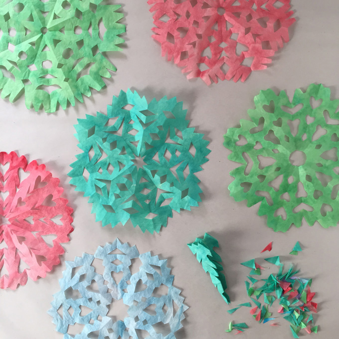 Kids paint and cut coffee filters to make these colorful snowflakes.