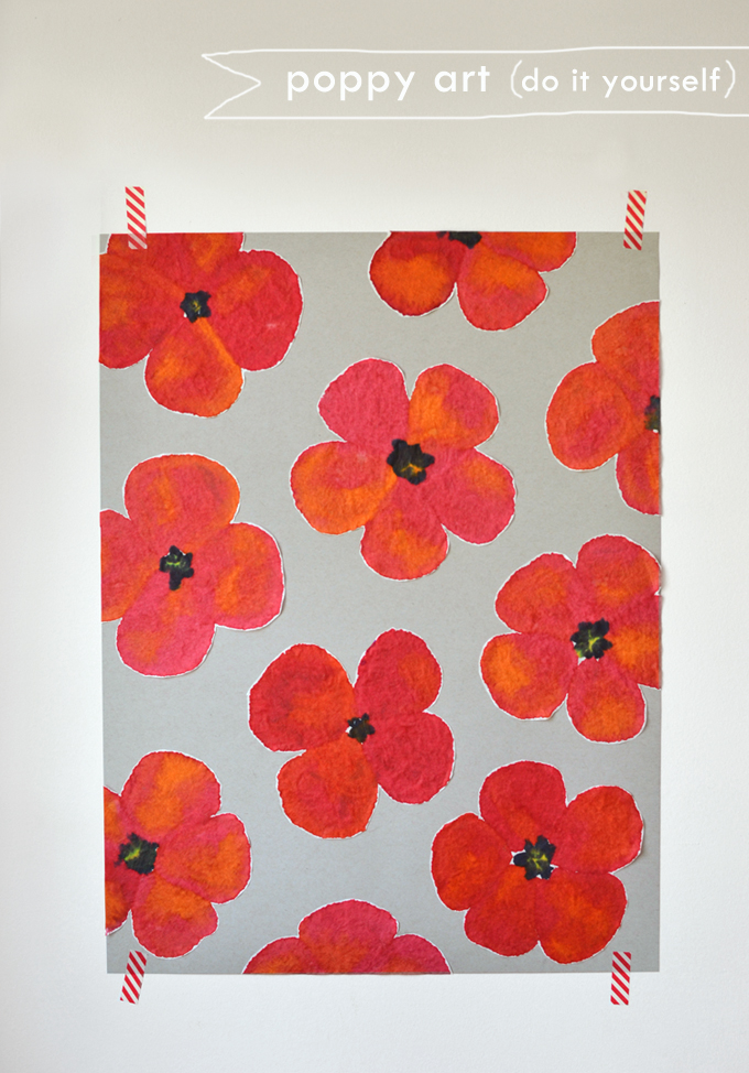 Children paint poppies using coffee filters and liquid watercolors.