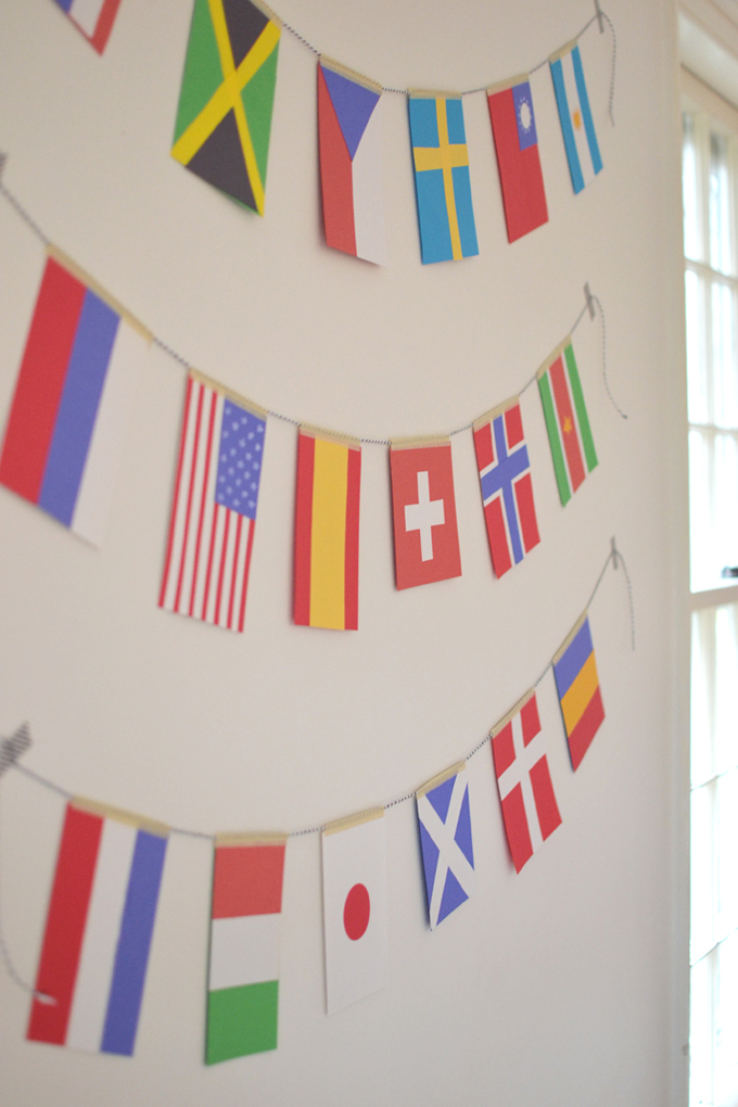 kids make world flag garland using library books and colored paper, celebrate Olympics