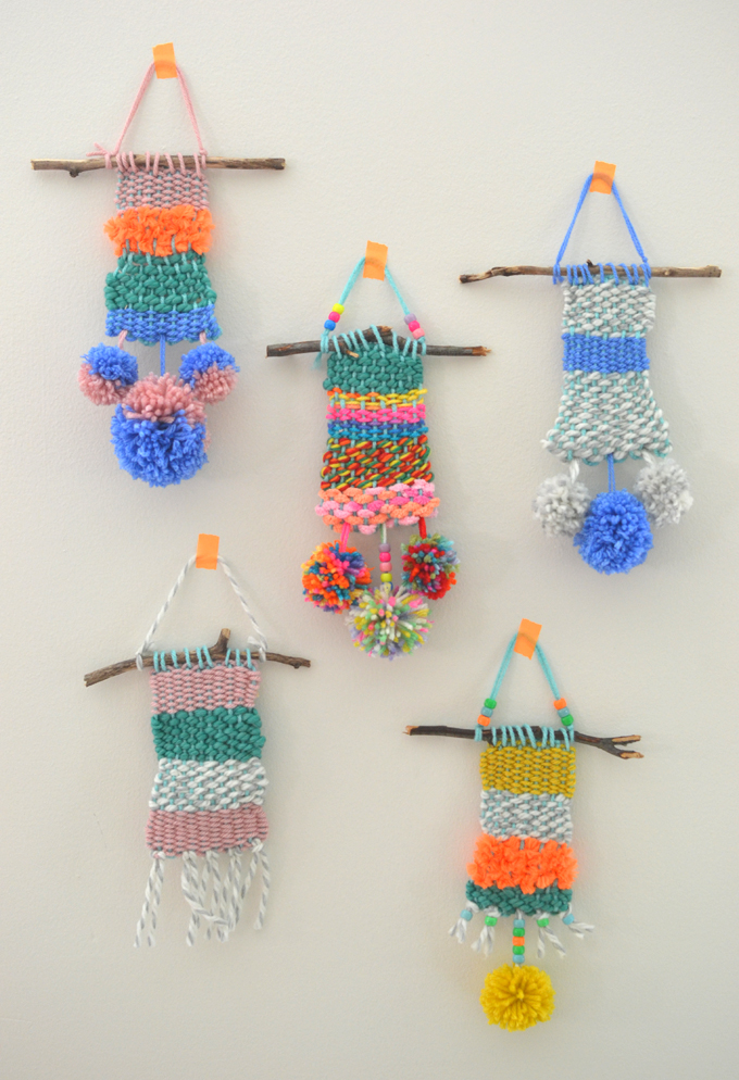 Children make small weavings with homemade cardboard looms. Perfect for ages 5 and up!