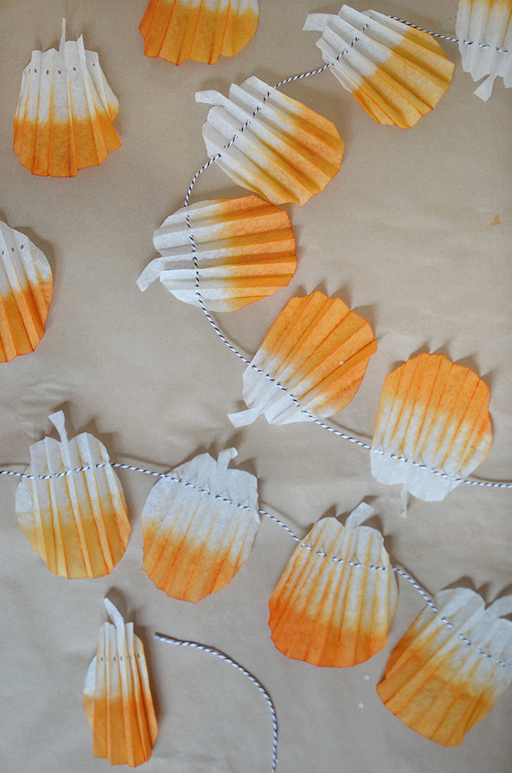 make this light and cheery pumpkin garland from coffee filters