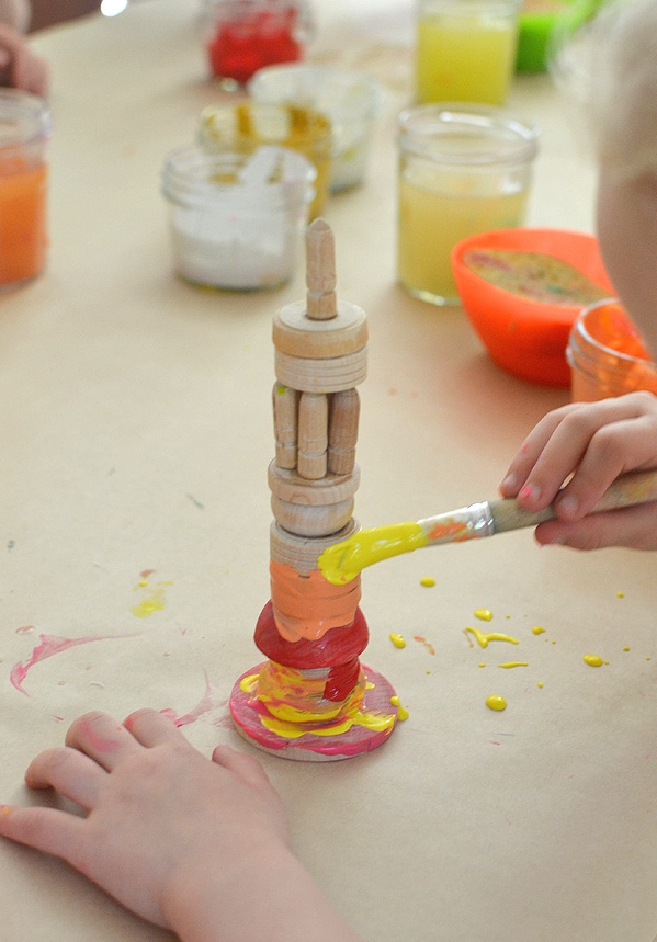 wooden towers built and painted by kids