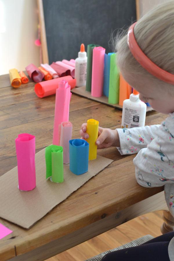 kids make rolled paper sculptures