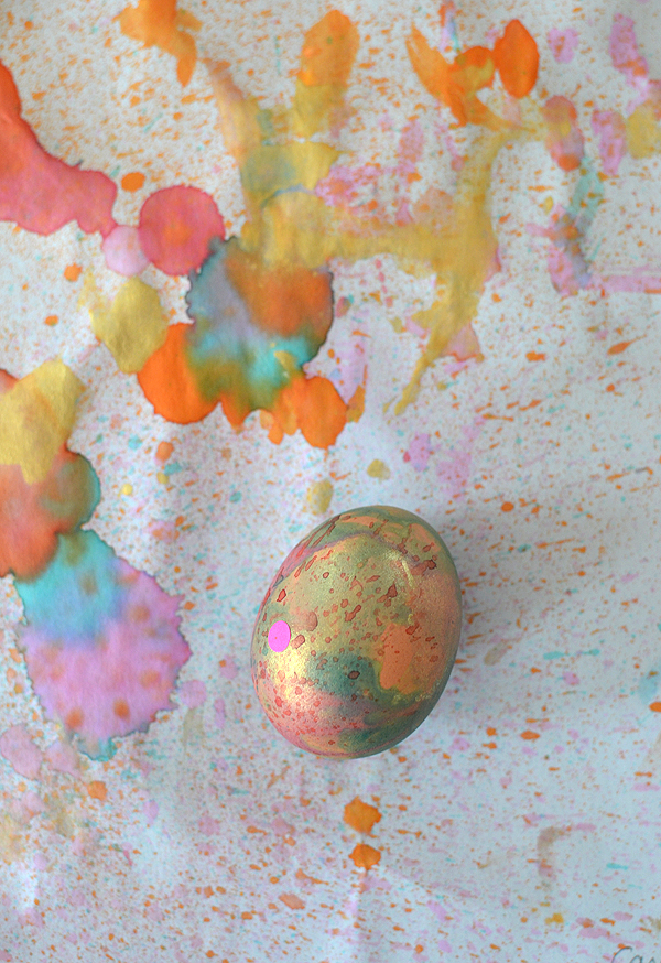 kids paint Easter eggs with a toothbrush