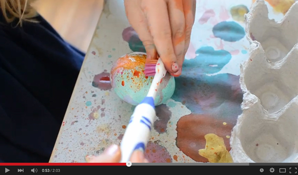 YouTube video of kids painting Easter eggs with a toothbrush