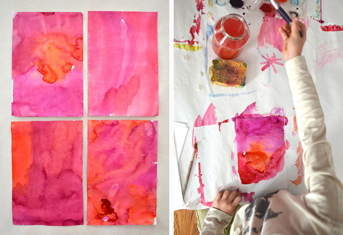 painting with liquid watercolor using 4 bright pink liquid watercolor paintings and a child's hand painting