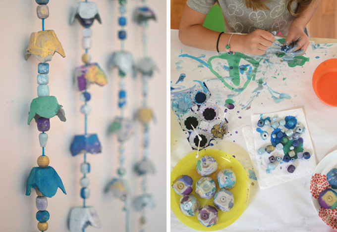 egg cartons craft painted with liquid watercolor and a child painting egg craton pieces with liquid watercolor paints