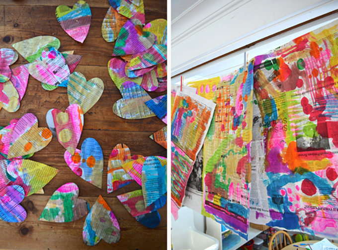 paint on newspaper using liquid watercolors and cut-out hearts with watercolor paint on them