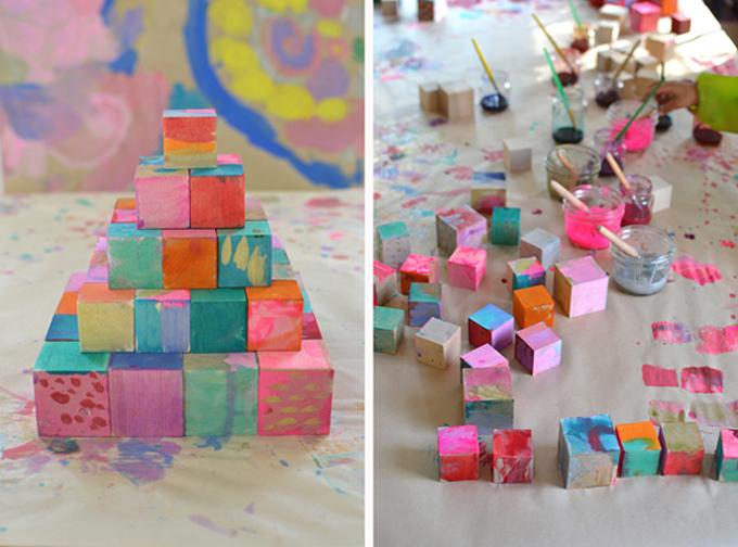 kids paint wooden blocks with liquid watercolor
