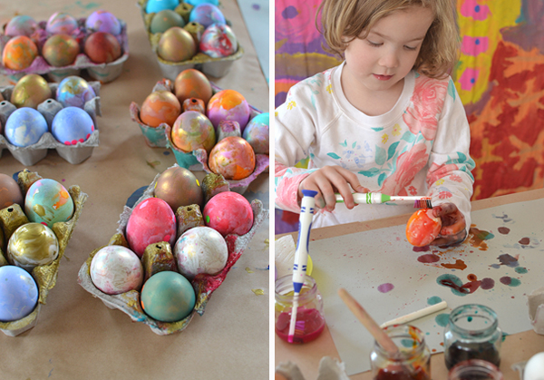 paint eggs with liquid watercolor and toothbrushes