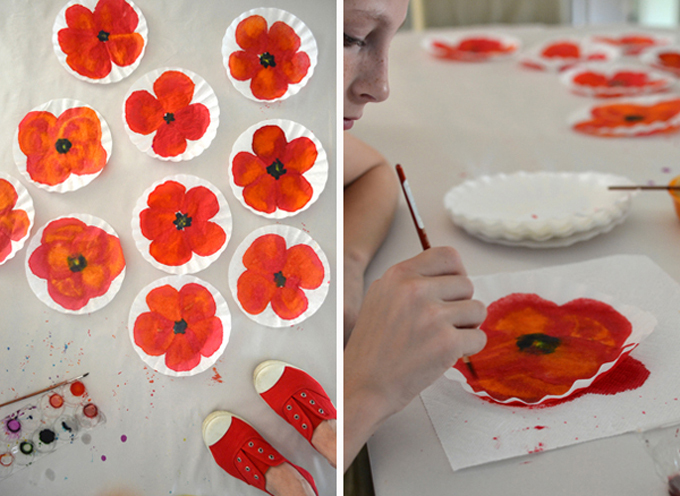 coffee filters with painted red poppies using liquid watercolor; also girl sitting at table painting with liquid watercolor paints