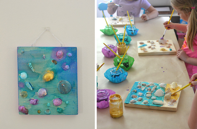 painting on shells and gluing to wood to make a shell collage
