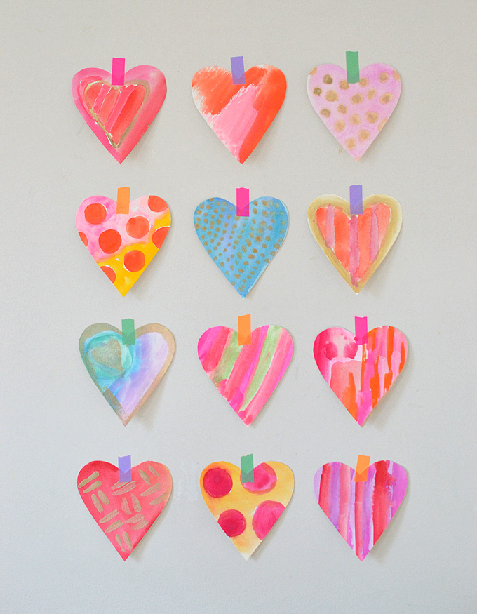 Simple technique to make a ton of watercolor hearts very quickly.
