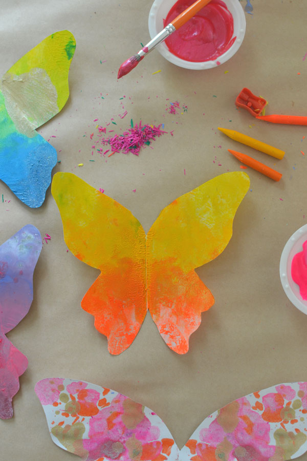 make these gorgeous butterflies from melted crayon shavings and printable butterfly sheets