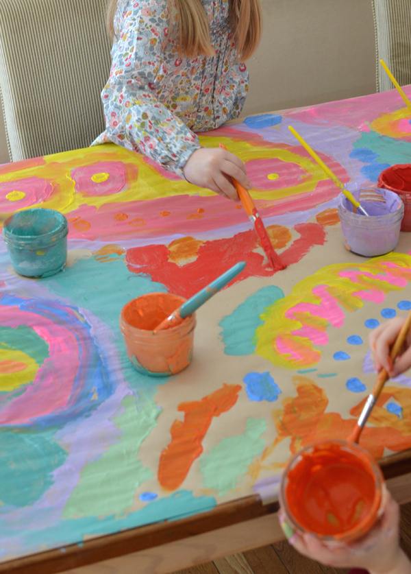 4yr olds work together to make a big painting ~ collaborative art projects foster cooperation