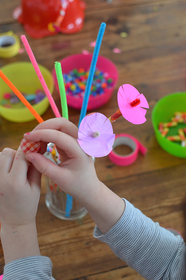 kids make a bouquet of pipe cleaner flowers with beads, buttons and paper