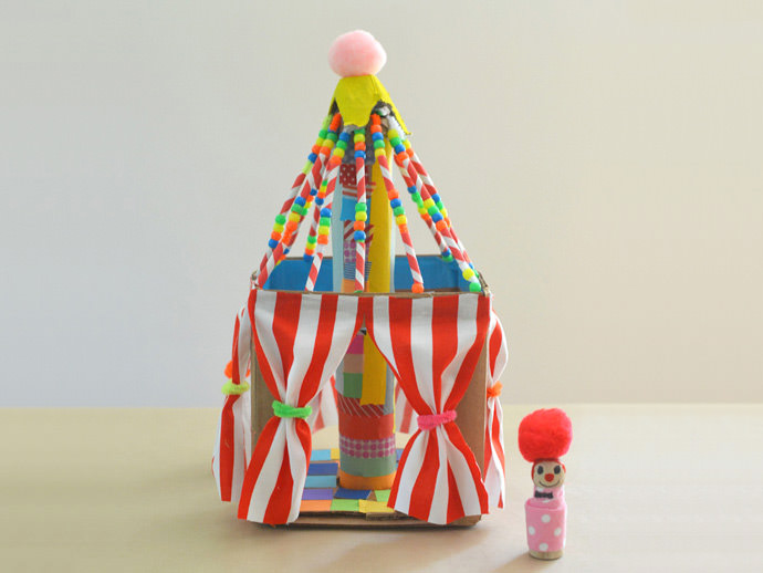 Finished circus tent craft for kids with little peg doll out in front