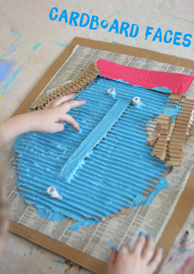 kids make giant faces with corrugated cardboard and tempera paint