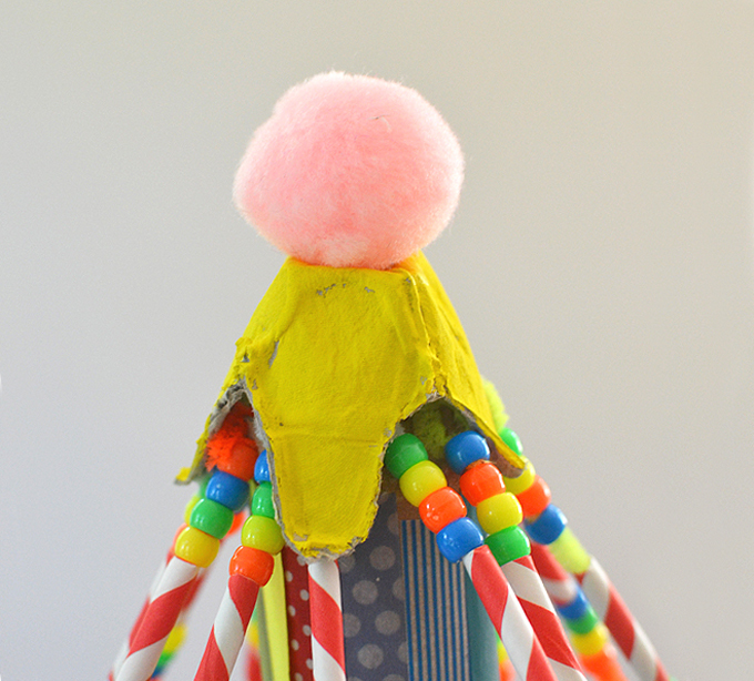 top of cardboard circus tent craft showing pom pom