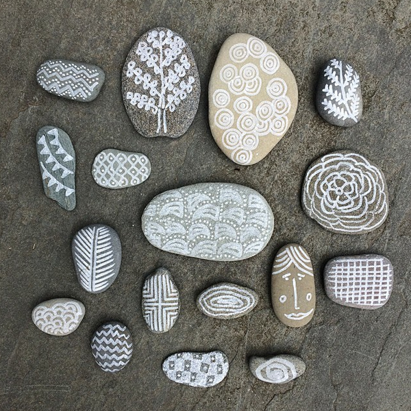 draw on stones with a white paint marker