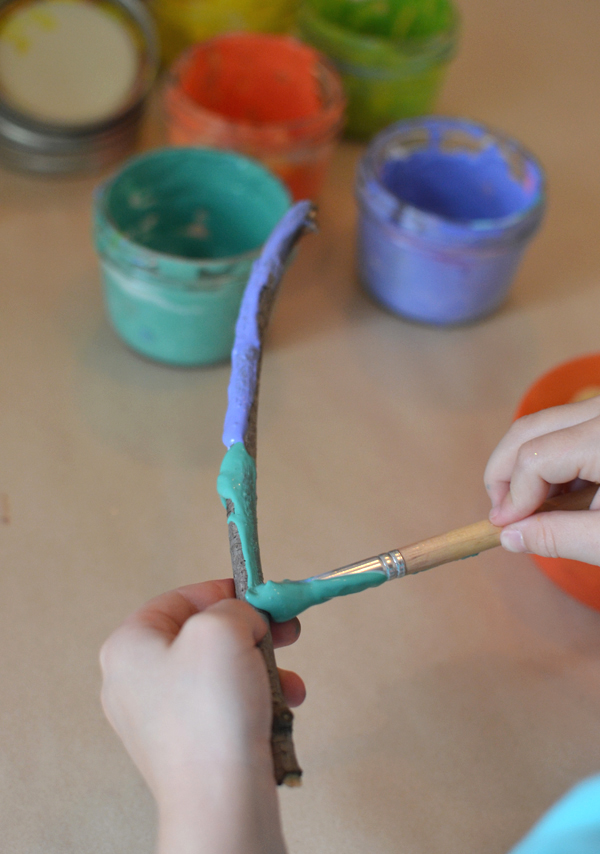 painting sticks with kids