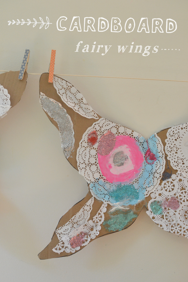 kids made these fairy wings using cardboard, doilies and paint