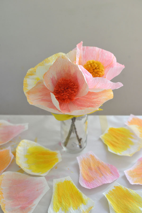 DIY handmade flowers with crepe paper and pom-poms
