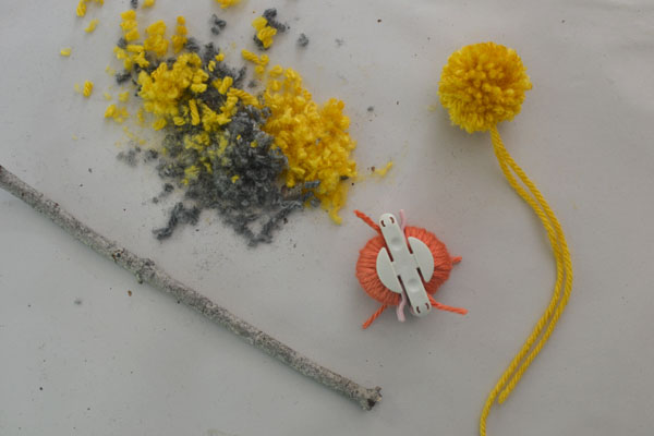 handmade flowers with crepe paper and pom-poms