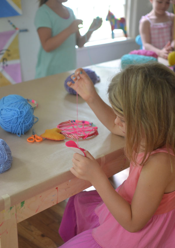 these dreamcatchers were made by 5-7yr olds in art camp