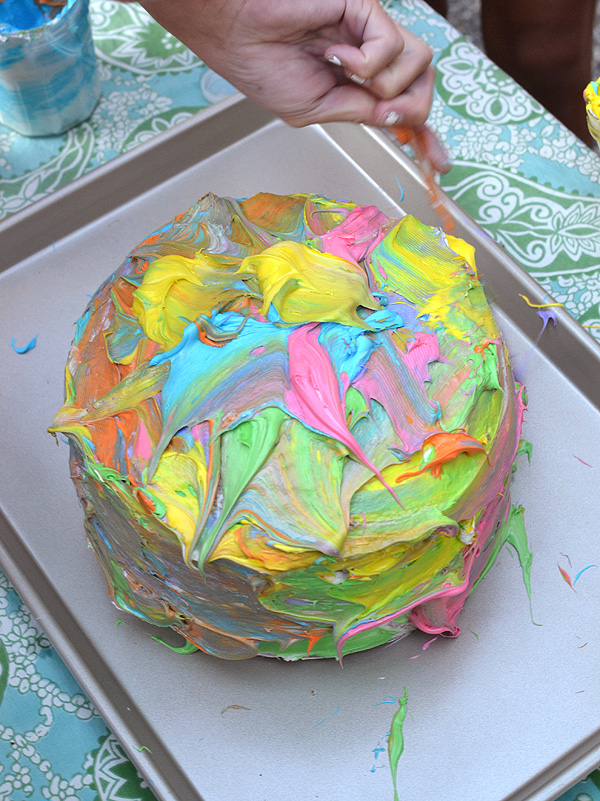 create a white cake and let the kids paint it with colored frosting