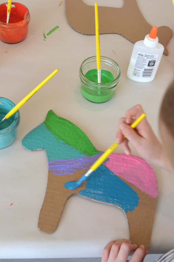 Cut Dala horse shapes from cardboard and let the kids paint and embellish - perfect party craft!