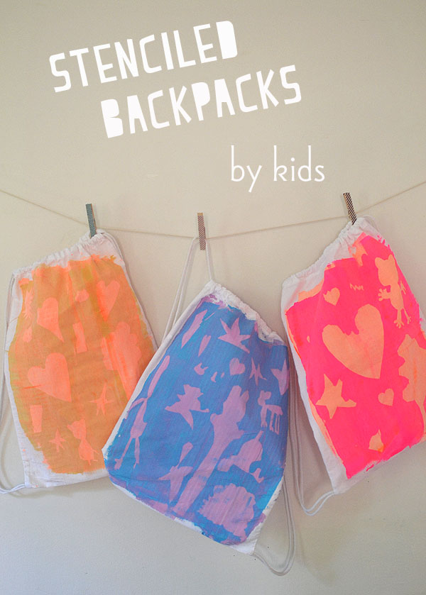kids design and paint their own backpacks using freezer paper and a scrape painting technique