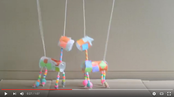 YouTube video of children making marionettes from TP rolls, tissue paper, and painted beads.
