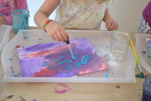 Kids paint with packing soda paint and vinegar to make fizzy works of art.
