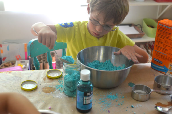 Kids make fizzing bath dough with three simple ingredients.