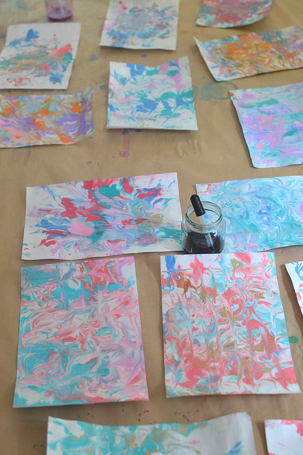 Children marble paper with shaving cream and liquid watercolors.