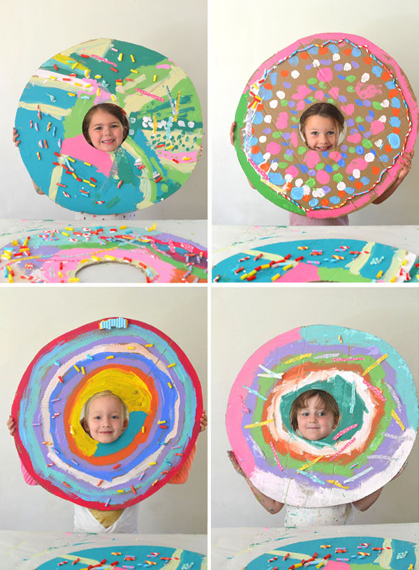 Kids paint and collage giant donuts cut from recycled cardboard.
